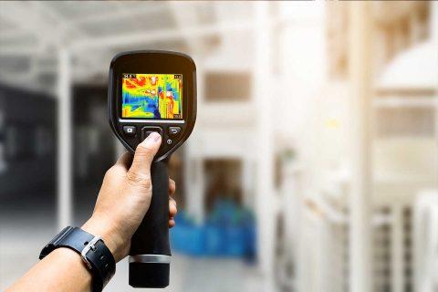 technician-use-thermal-imaging-camera-check-temperature-factory