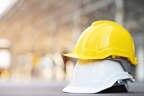 yellow-white-hard-safety-wear-helmet-hat-project-construction-site-building-concrete-floor-with-sunlight-helmet-workman-as-engineer-worker-concept-safety-first